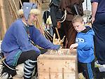 A child plays a viking board game the Annagassan Viking Festival. Photo: Colin Bell/pressphotos.ie