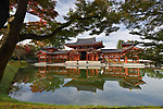 Peaceful autumn scenery of the Phoenix Hall, Amida hall of Byodoin temple on Kojima island of Jodoshiki teien, Pure Land garden pond on a bright sunny morning. Uji, Kyoto Prefecture, Japan 2017 Image © MaximImages, License at https://www.maximimages.com