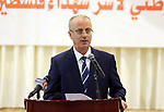 Palestinian Prime Minister, Rami Hamdallah, attends the breakfast for the martyrs families, in the West Bank city of Ramallah, on June 15, 2017. Photo by Prime Minister Office