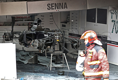 13.05.2012. Catalunya, Barcelona, Spain. A Fireman walks in front of Williams team garage after a fire after the Grand Prix of Spain at the Circuit de Catalunya in Montmelo near Barcelona, Spain, 13 May 2012.