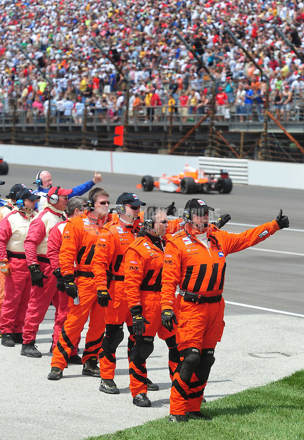 May 25, 2008; Indianapolis, IN, USA; IRL drivers receive thumbs up from safety workers prior to the start of the 92nd running of the Indianapolis 500 at the Indianapolis Motor Speedway. Mandatory Credit: Mark J. Rebilas-