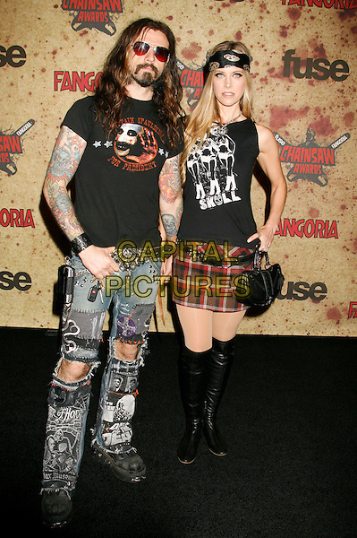 ROB ZOMBIE & SHERI MOON ZOMBIE.Fuse Fangoria Chainsaw Awards held at The Orpheum Theatre, Los Angeles, California, USA - Arrivals.October 15th, 2006.Ref: ADM/RE.full length jeans denim ripped torn tattoos plaid skirt boots black sunglasses shades.www.capitalpictures.com.sales@capitalpictures.com.©Russ Elliot/AdMedia/Capital Pictures.