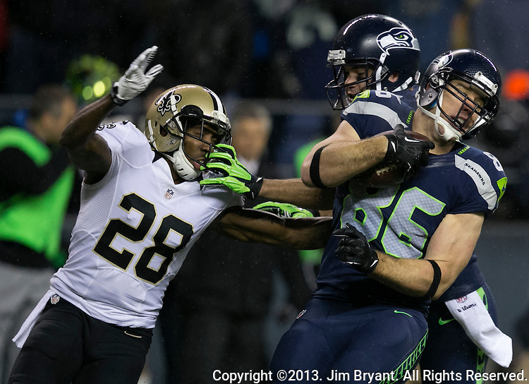 Seattle Seahawks tight end Zach Miller (86) escapes the tackle of  New Orleans Saints cornerback Keenan Lewis (28) and runs for a first down during the first quarter at CenturyLink Field in Seattle, Washington on December 2, 2013. The Seahawks lead the Saints 27-7 at the half.  ©2013. Jim Bryant Photo. ALL RIGHTS RESERVED.