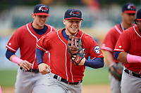New Hampshire Fisher Cats right fielder Andrew Guillotte (1) runs off the field followed by Cavan Biggio (6) during the first game of a doubleheader against the Harrisburg Senators on May 13, 2018 at FNB Field in Harrisburg, Pennsylvania.  New Hampshire defeated Harrisburg 6-1.  (Mike Janes/Four Seam Images)