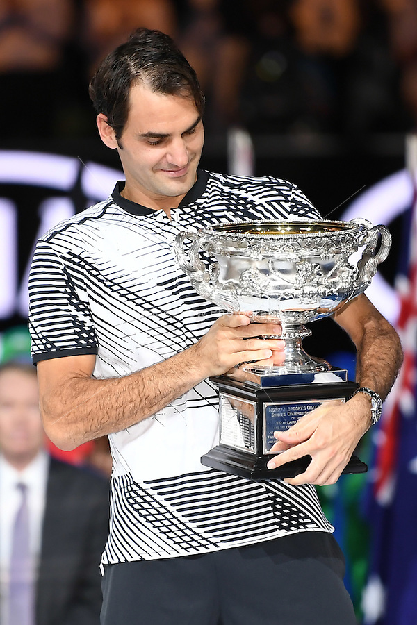 January 29, 2017: Roger Federer of Switzerland accepts the trophy from Rod Laver after winning the Men's Final against Rafael Nadal of Spain on day 14 of the 2017 Australian Open Grand Slam tennis tournament in Melbourne, Australia. Photo Sydney Low