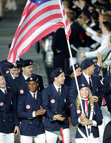 27.07.2012. London England.  Olympic team of USA with flag bearer and fencer Mariel Zagunis arrive into the Olympic stadium during the Opening Ceremony of the London 2012 Olympic Games, London, Britain, 27 July 2012. The 2012 Summer Olympic Games will be held in London from 27 July to 12 August 2012.
