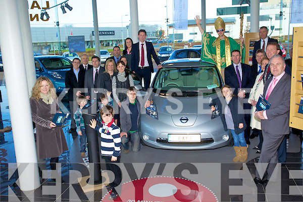Paula Luck owner of the first electric car in Europe with Management and staff at Randles garage, Tralee
