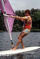 Saint-Sauveur, PQ, Canada - June 30, 1979. This photograph was taken of Robert Charlebois windsurfing on the lake infront of his home near Montreal. Robert Charlebois (born June 25, 1944) is a Quebec author, composer, musician, performer and actor. He is an important figure in French music and his best known songs include Lindberg and Je reviendrai à Montréal.