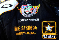 Aug. 3, 2014; Kent, WA, USA; Detailed view of the championship patch on the fire suit of NHRA top fuel dragster driver Tony Schumacher during the Northwest Nationals at Pacific Raceways. Mandatory Credit: Mark J. Rebilas-