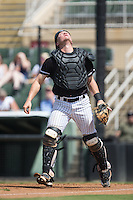 Kannapolis Intimidators catcher Nate Nolan (24) tracks a pop fly during the game against the Greensboro Grasshoppers at Intimidators Stadium on July 17, 2016 in Greensboro, North Carolina.  The Intimidators defeated the Grasshoppers 3-2 in game one of a double-header.  (Brian Westerholt/Four Seam Images)