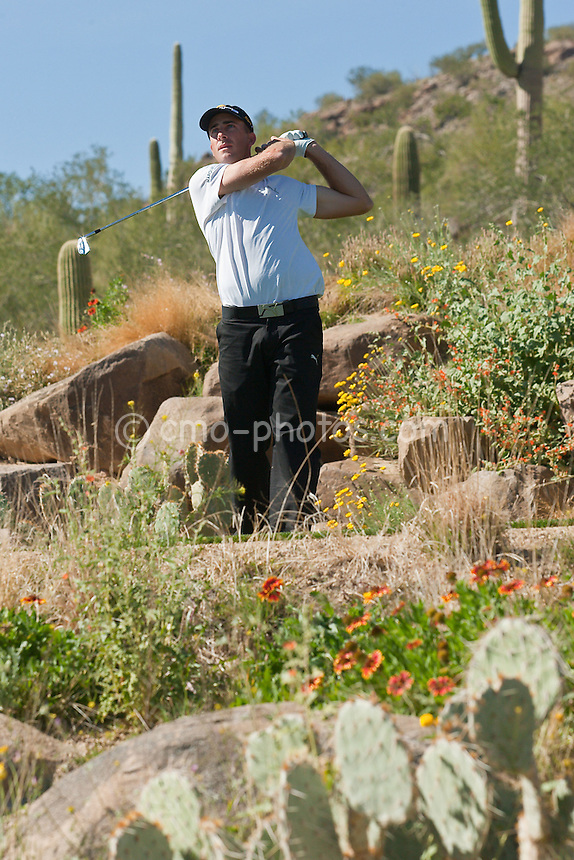 Feb 28, 2009; Marana, AZ, USA; Geoff Ogilvy (AUS) watches his tee shot on the 12th hole during the semifinal round of the World Golf Championships-Accenture Match Play Championship at the Ritz-Carlton Golf Club, Dove Mountain.