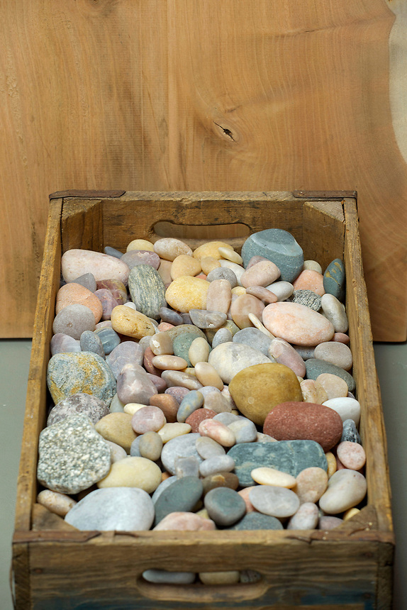 Pebbles in a wooden box