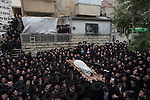 Ultra-orthodox Jewish men carry the body of Rabbi Refoel Shmulevitz, wrapped in a prayer shawl, during his funeral in Jerusalem, Israel. Rabbi Shmulevitz was the head of Mir Yeshiva, one of the largest Yeshivas in Israel with more than 7500 students coming from all over the world.