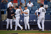 New York Yankees pinch runner Tyler Wade (94) high fives manager Joe Girardi and coach Rob Thomson (left) during a Spring Training game against the Detroit Tigers on March 2, 2016 at George M. Steinbrenner Field in Tampa, Florida.  New York defeated Detroit 10-9.  (Mike Janes/Four Seam Images)