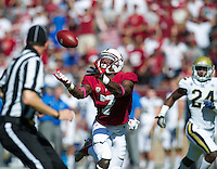 STANFORD, CA - October 19, 2013:  Stanford Cardinal wide receiver Ty Montgomery (7) stretches for a catch during the Stanford Cardinal vs the UCLA Bruins at Stanford Stadium in Stanford, CA. Final score Stanford Cardinal 24, UCLA Bruins  10.