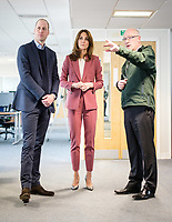 19/03/2020 - Picture released by Kensington Palace of Prince William Duke of Cambridge and Kate Duchess of Cambridge talking with Chief Executive of the London Ambulance Service, Garrett Emmerson, during a visit to the London Ambulance Service 111 control room in Croydon on Thursday to meet staff who have been taking NHS 111 calls from the public, and thank them for the vital work they are doing. Photo Credit: ALPR/AdMedia