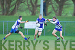 Laune Rangers Peter Crowley powers through the Keel midfielders Tomas Ladden and Maurice Moriarty in the Mid Kerry championship quarter final in Killorglin on Saturday