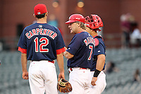 Memphis Redbirds manager Chris Maloney #7 makes a pitching change during a game versus the Round Rock Express at Autozone Park on April 30, 2011 in Memphis, Tennessee.  Matt Carpenter #12 and catcher Tony Cruz #18 (partially hidden) look on.  Memphis defeated Round Rock by the score of 10-7.  Photo By Mike Janes/Four Seam Images
