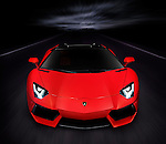 Red 2014 Lamborghini Aventador LP 700-4 Roadster supercar on the road at night front view