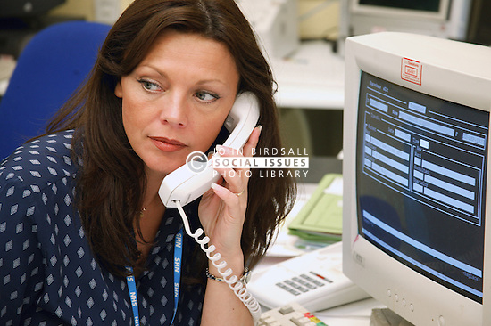 Ward Receptionist on the telephone,