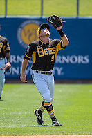 Alex Yarbrough (9) of the Salt Lake Bees looks into the sun for a high fly ball on defense against the Albuquerque Isotopes in Pacific Coast League action at Smith's Ballpark on June 28, 2015 in Salt Lake City, Utah. The Isotopes defeated the Bees 8-3. (Stephen Smith/Four Seam Images)