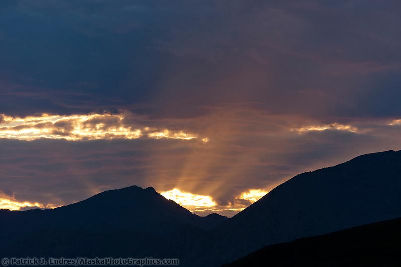 Midnight sun sets over the Brooks range mountains, Arctic National Wildlife Refuge, arctic, Alaska.