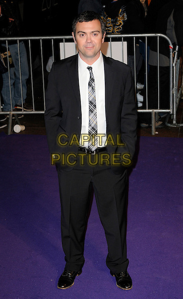 """JOE TRUGLIO.The """"Paul"""" UK Film Premiere, Empire Cinema, Leicester Square, London, England, UK,.7th February 2011.full length white shirt black grey gray suit jacket plaid tartan tie hands in pockets .CAP/CAN.©Can Nguyen/Capital Pictures."""