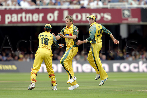 2 July 2005: Australian bowler Glenn McGrath is congratulated by team mates after taking a wicket during the NatWest Series final between England and Australia at Lords, London. The match ended in a tie, with both sides scoring 196 runs. Photo: Neil Tingle/Actionplus..050702 cricketers players cricket celebrate celebration joy
