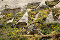 Pigeon coops carved out of the hillside behind Goreme village, Cappadocia, Turkey