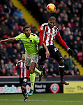 Leon Clarke of Sheffield United tussles with Lewin Nyatanga of Northampton Town in the air during the English Football League One match at Bramall Lane, Sheffield. Picture date: December 31st, 2016. Pic Jamie Tyerman/Sportimage