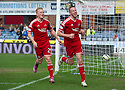 Aberdeen's Adam Rooney (9) celebrates with Andrew Driver (29) after he scores their first goal.