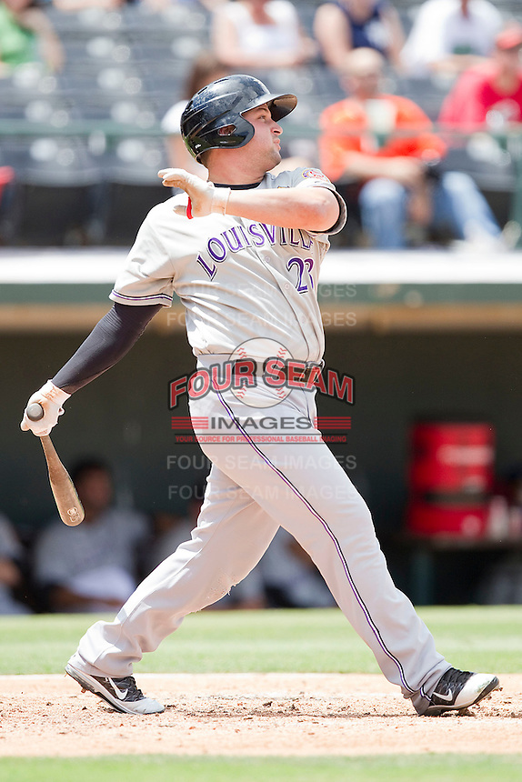 Yonder Alonso #23 of the Louisville Bats follows through on his swing against the Charlotte Knights at Knights Stadium on July 17, 2011 in Fort Mill, South Carolina.  The Knights defeated the Bats 7-6.   (Brian Westerholt / Four Seam Images)