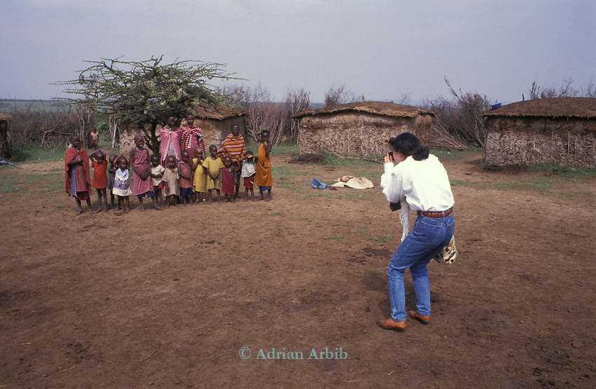 An Japanese tourist  in a  Maasai cultural manyatta  set up to interface the Maasai directly with tourists.