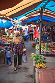 INDONESIA, Flores, a Muslim woman and her daughter browse for produce at the Bajawa market in Bajawa