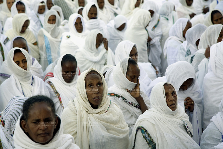 Eritrea. Maekel province. Asmara. St Michael church. A crowd of black women, dressed in white clothes and covering their hair with white veils (cotton loincloth), is praying on St Michael's day during an orthodox religious service.  © 2006 Didier Ruef