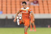 Houston, TX - Saturday July 08, 2017: Carli Lloyd gains control of a loose ball during a regular season National Women's Soccer League (NWSL) match between the Houston Dash and the Portland Thorns FC at BBVA Compass Stadium.