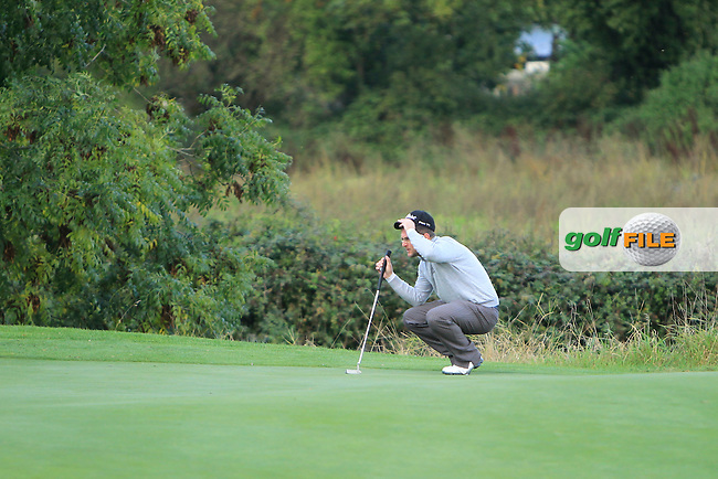 Glen Robinson (St. Helen's Golf Resort) on the 8th green during Round 2 of The Cassidy Golf 103rd Irish PGA Championship in Roganstown Golf Club on Friday 11th October 2013.<br /> Picture:  Thos Caffrey / www.golffile.ie