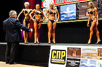 23/10/2010. Irish female physique and figure fitness national championships.  Mick Bullman RIBBF president speaks to contestants onstage during the female physique category as part of the 2010 RIBBF national bodybuilding championships at the University of Limerick Concert Hall, Limerick, Ireland. L-R are Inga Beimore from Dublin, Katarina Cienka  from Dublin, Leona Spellman from Galway and Ligita Kriksciunaite from Dublin. Picture James Horan.