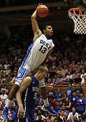 Freshman Michael Gbinije (13) dunks over Mason Plumlee (5) during the dunk contest. Photo by Al Drago...