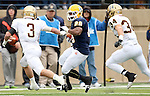 SIOUX FALLS, SD - NOVEMBER 16: CJ Ham #28 from Augustana looks for running room past Tate Bunkers #3 and  Blake Pennock #34 from Southwest Minnesota State in the second quarter of their game Saturday at Augustana. (Photo by Dave Eggen/Inertia)