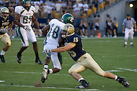 01 September 2007:Pittsburgh linebacker Shane Murray (15) wraps up Eastern Michigan wide receiver Dave Brytus (18)..The Pitt Panthers defeated the Eastern Michigan Eagles 27-3 at Heinz Field, Pittsburgh, Pennsylvania.