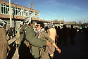 Iran 1979.Peshmergas of KDPI entering Echnou, two friends meetingt