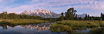 Morning light on the Tetons above a pond in Grand Teton National Park, Wyoming.
