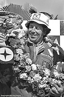 LONG BEACH, CA - APRIL 3: Mario Andretti celebrates in victory lane after winning the United States Grand Prix West on April 3, 1977, at the temporary street circuit in Long Beach, California.