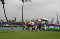 Shane Lowry (IRL), Adilson Da Silva (BRA) and Adam Groom (AUS) wait to tee off on the 7th tee during Friday's resumed Round 2 of the 2011 Barclays Singapore Open, Singapore, 11th November 2011 (Photo Eoin Clarke/www.golffile.ie)