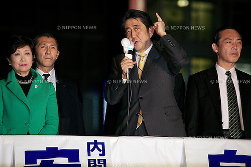 """Shinzo Abe, November 28, 2014 : Japan's Prime Minister and leader of the Liberal Democratic Party (LDP) Shinzo Abe speaks to pedestrians and media outside Shinjuku Station on November 28, 2014 in Tokyo, Japan. Abe dissolved the Lower House of Japan's Parliament calling a surprise general election for December 14 just 2 years in to his 4 year term. The election is seen as a way to bolster support for Abe's policies including """"Abenomics"""" and his decision to delay a planned rise in Japan's consumption tax rate to 10 percent until April 2017. (Photo by Rodrigo Reyes Marin/AFLO("""