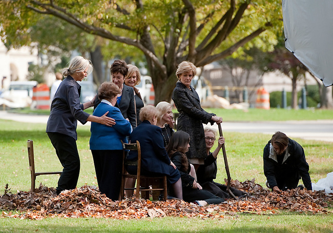 UNITED STATES – OCTOBER 18: Celebrity photographer Annie Leibovitz, center, positions her portrait subjects during a photo shoot on the U.S. Capitol grounds on Tuesday, Oct. 18, 2011. The group sitting for the photograph include Sen. Barbara Mikulski, D-Md., Rep. Carolyn Maloney, D-N.Y., Sen. Susan Collins, R-Maine, Del. Eleanor Holmes Norton, D-D.C., President George Bush's daughter Barbara, Former U.S. Secretary of State Madeleine Albright, Tricia Nixon Cox, Joan Bradley Wages, President & CEO of the NWHM and actress Meryl Streep. (Photo By Bill Clark/CQ Roll Call)