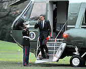 Washington, D.C. - December 4, 2009 -- United States President Barack Obama salutes the Marine Guard as he returns to the White House aboard Marine 1 after visiting Allentown, Pennsylvania on Friday, December 4, 2009 to discuss jobs and the economy..Credit: Ron Sachs / Pool via CNP
