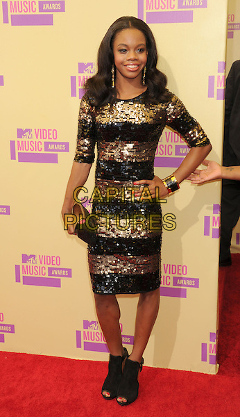 Gabby Douglas.arriving at the 2012 MTV Video Music Awards at Staples Center in Los Angeles, California, USA, .September 6th, 2012..arrivals vmas vma  full length gold black striped dress hand on hip sequined sequin .CAP/ROT/TM.©TM/Roth Stock/Capital Pictures