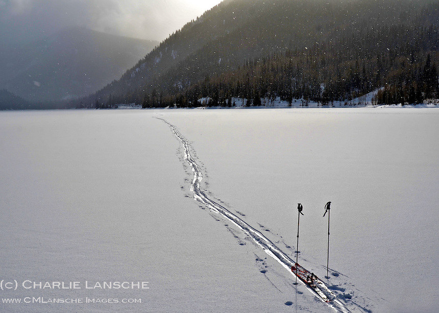 I quick stop to photograph my tracks on the frozen surface of a high country lake in the Uinta Mountains.  .